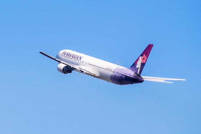 Hawaiian Airlines aircraft up in the air royalty free stock image