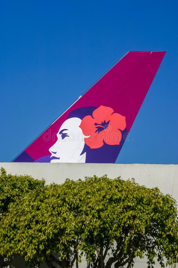 Hawaiian Airlines tail section at the Honolulu Airport stock image