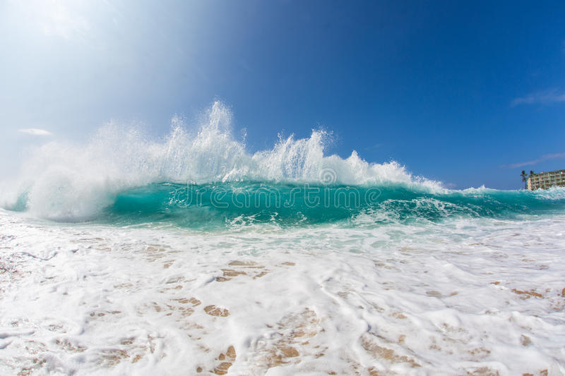 Hawaiian Bright Blue Shorebreak Pacific ocean wave. Ocean Background Big Shorebreak Wave for Surfing. Hawaiian swell for sport activity. Power and Energy Of stock photos