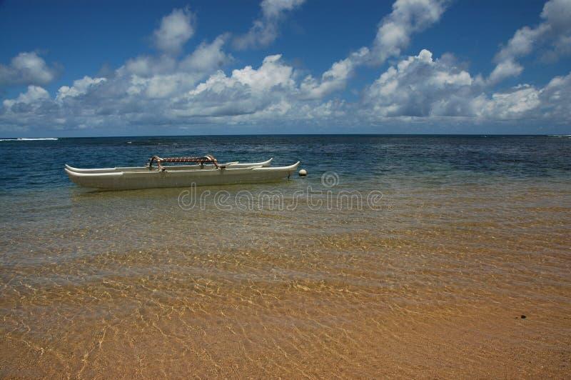 Hawaiian Canoe in Paradise stock images