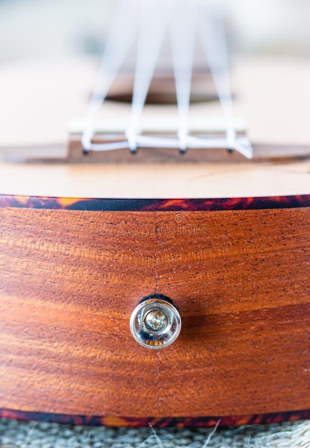 Hawaiian guitar. Ukulele wooden instrument. Learning to play. The perfect picnic instrument. Soft sounds. Soprano ukulele. royalty free stock images