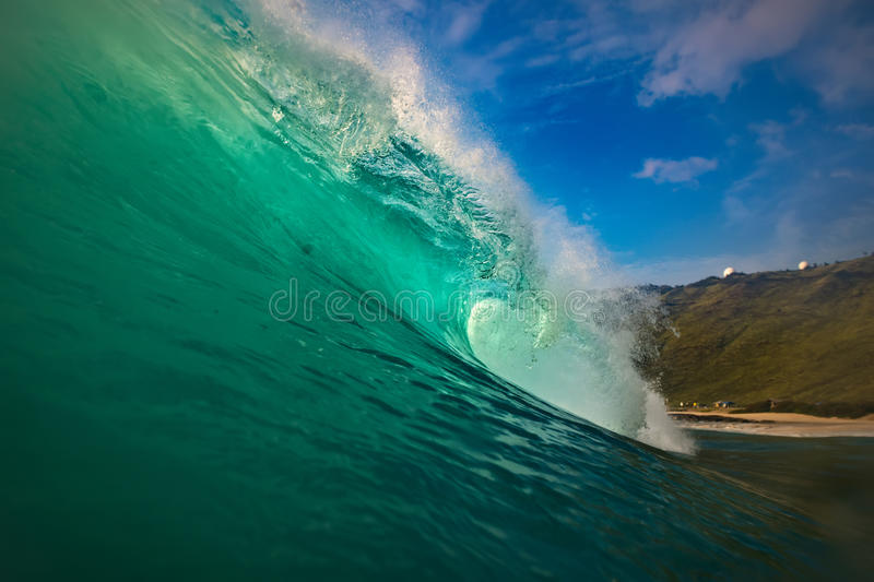 Surfing wave green blue barrel in Hawaii stock photography
