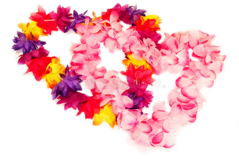 Hawaiian leis in heart shape royalty free stock photography