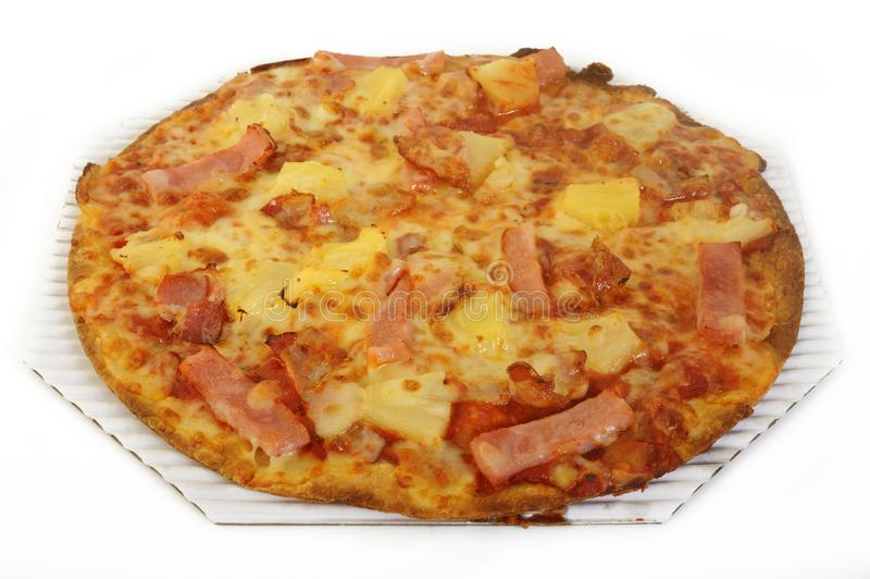 Hawaiian pizza topped. With pineapple and ham on white background royalty free stock photos
