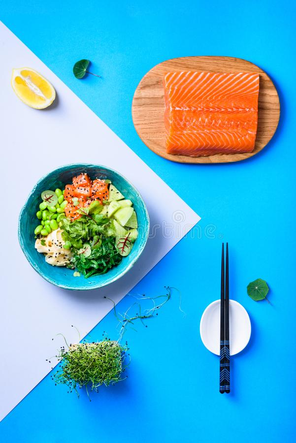 Hawaiian poke bowl with salmon, noodle and edamame. Asian trendy food royalty free stock image