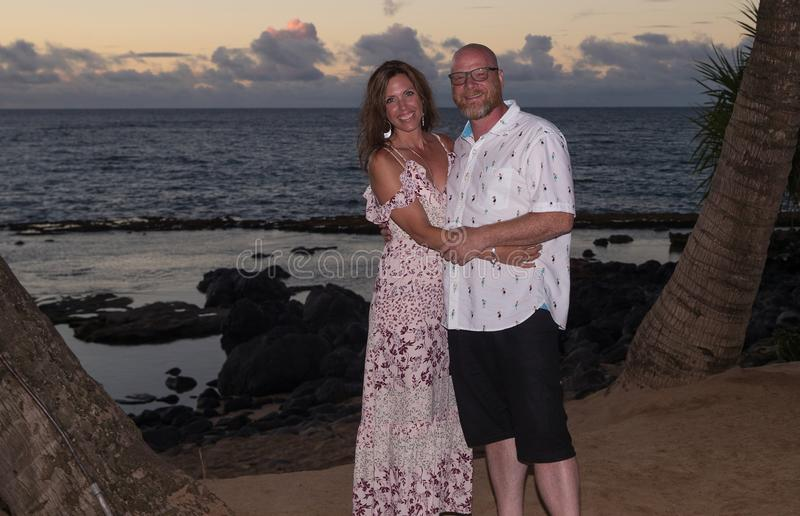 Hawaiian tourists on vacation. Man and women at tropical island royalty free stock images