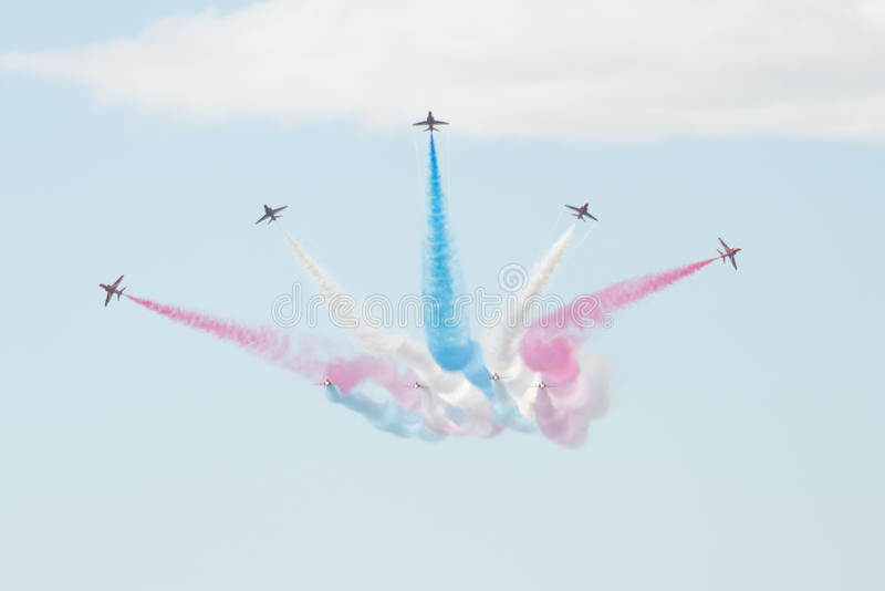 Hawk T1 jets with colored smokes on air show. Air show, Hawk T1 jets on air show performing with colored smokes stock images