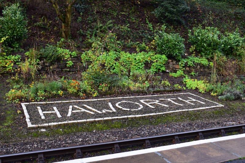 Download Haworth tecken fotografering för bildbyråer. Bild av tecken - 76703513