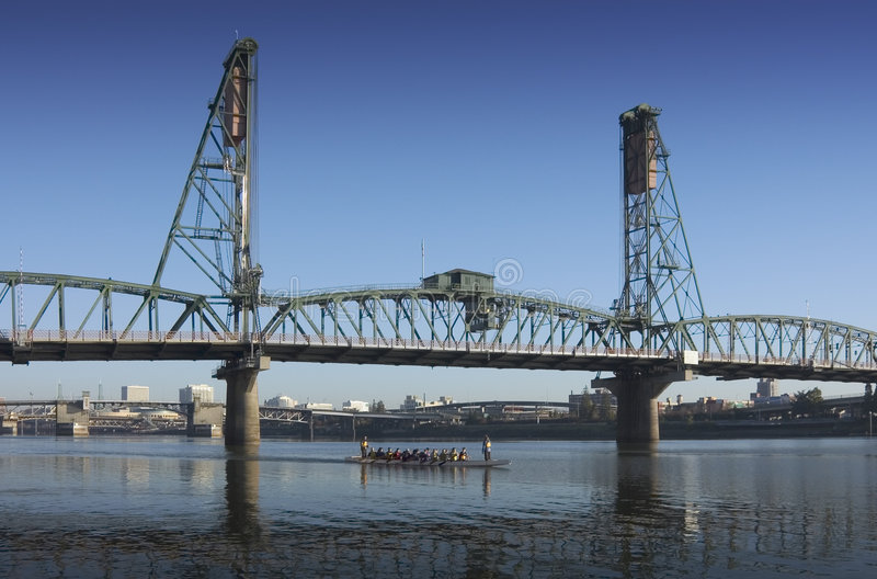 Hawthorne bridge. A group of rowers rowing up the williamette river in portland oregon with hawthorne bridge stock photos