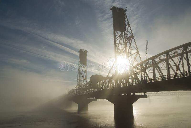 The Hawthorne Bridge with fog. The Hawthorne Bridge in Portland, Oregon with fog and sun royalty free stock photos