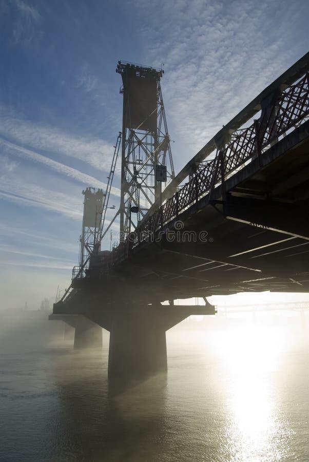 The Hawthorne Bridge with fog. The Hawthorne Bridge in Portland, Oregon with fog and sun royalty free stock image