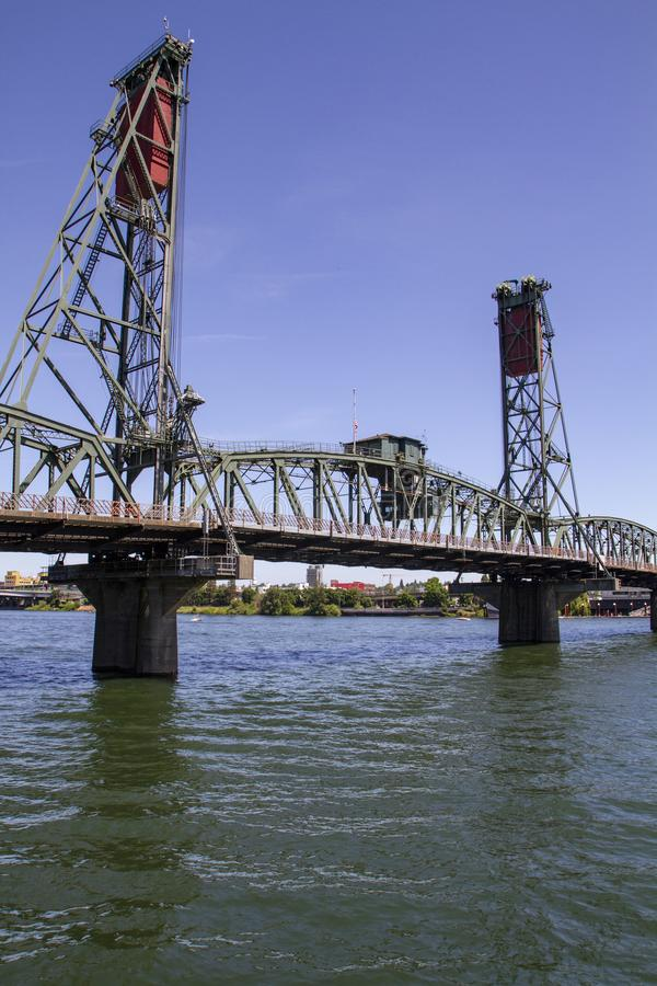 Hawthorne Bridge in fully lowered position on a Late Sunny Summer Afternoon on the Willamette River in Portland Oregon. Vertical image of the Hawthorne Bridge royalty free stock photos