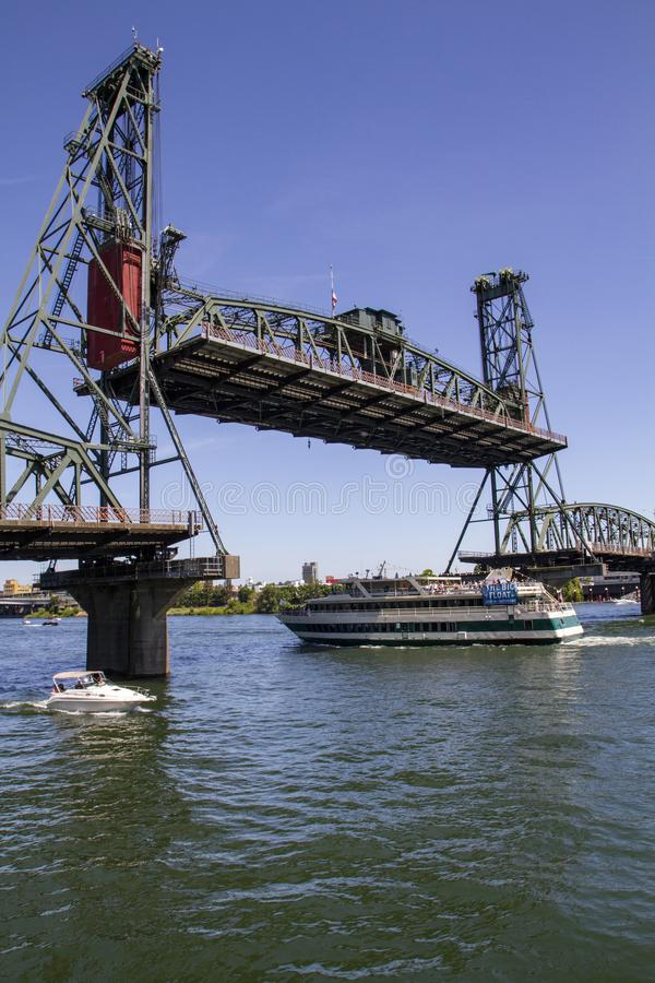 Hawthorne Bridge in fully raised position on a Late Sunny Summer Afternoon on the Willamette River in Portland Oregon. Vertical image of the Hawthorne Bridge royalty free stock image