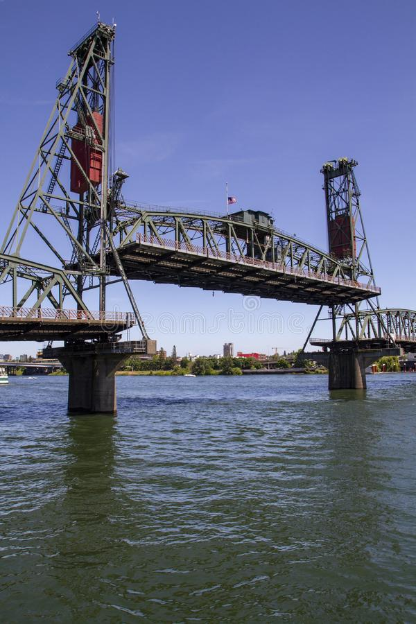 Hawthorne Bridge in nearly fully raised position on a Late Sunny Summer Afternoon on the Willamette River in Portland Oregon. Vertical image of the Hawthorne royalty free stock photos