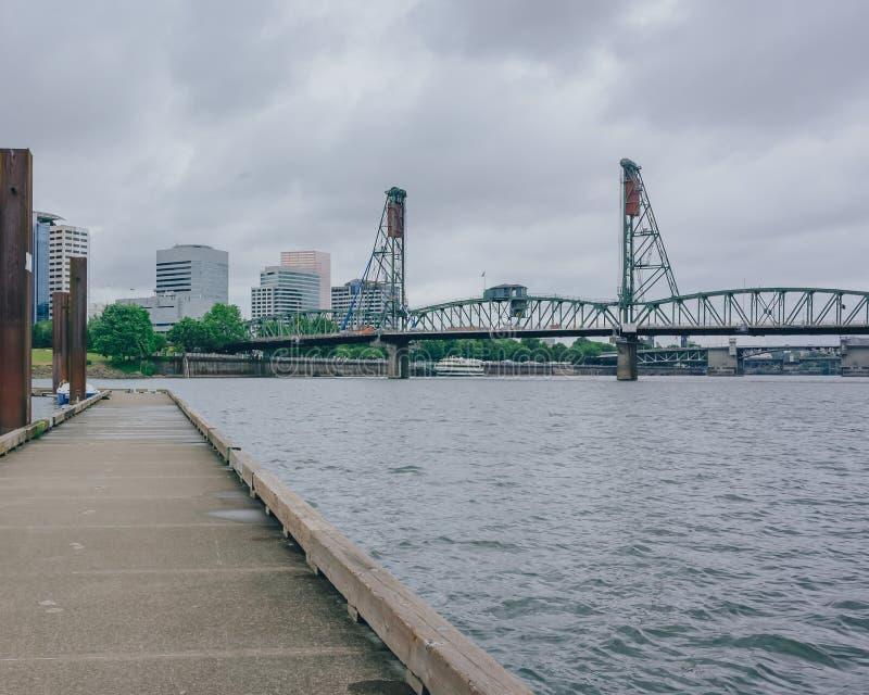 Hawthorne Bridge over Willamette River in downtown Portland, USA. View of Hawthorne Bridge over Willamette River in downtown Portland, USA royalty free stock image