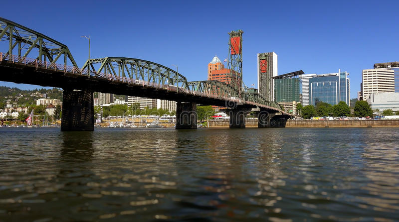 Hawthorne Bridge Over Willamette River in Portland, Oregon. The Hawthorne Bridge crosses over the Willamette River and leads into Portland, Oregon royalty free stock photography
