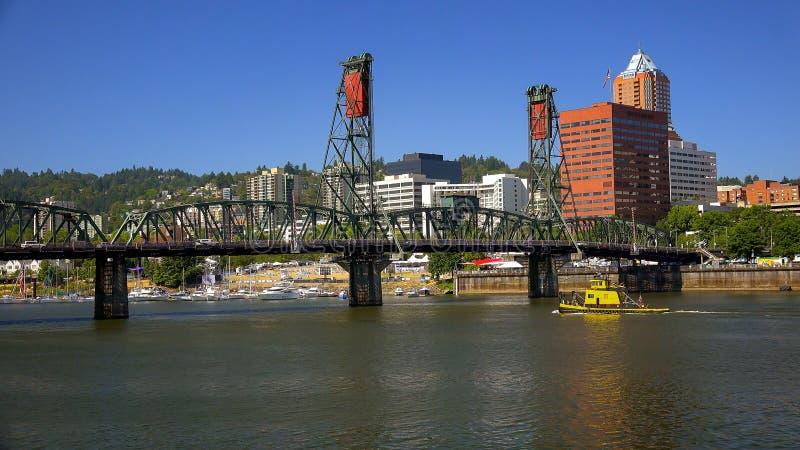 Hawthorne Bridge Over Willamette River in Portland, Oregon. The Hawthorne Bridge crosses over the Willamette River and leads into Portland, Oregon royalty free stock image