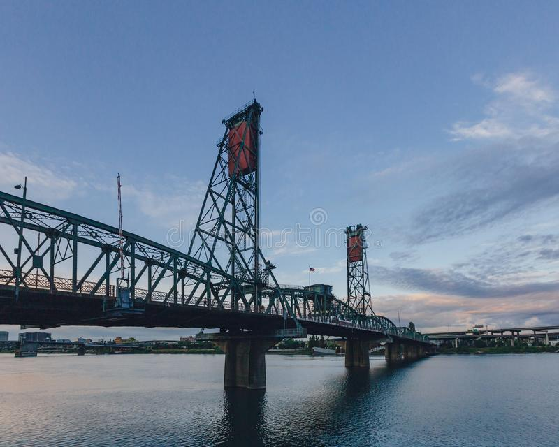 Hawthorne Bridge over Willamette River at sunset in downtown Portland, USA. View of Hawthorne Bridge over Willamette River at sunset in downtown Portland, USA stock photos