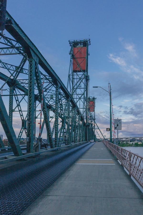 Hawthorne Bridge over Willamette River at sunset and its vertical lifts in downtown Portland, USA. View of Hawthorne Bridge over Willamette River at sunset and stock photos