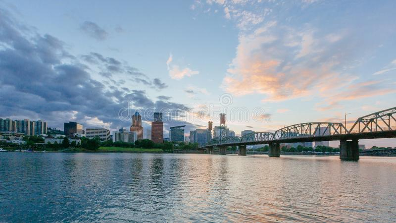 Hawthorne Bridge over Willamette River at sunset with skyline of downtown Portland, USA stock photo