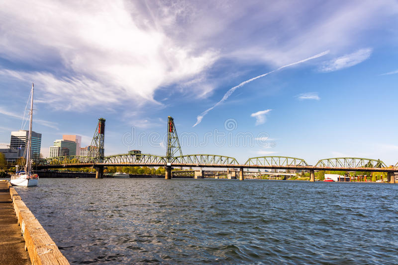 Hawthorne Bridge and Pier. View of the Hawthorne Bridge from a pier in downtown Portland, Oregon royalty free stock photo
