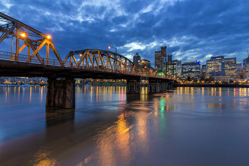 Hawthorne Bridge to Portland Downtown at Night. Hawthorne Bridge Over Willamette River to Portland Oregon Downtown with Water Reflection During Evening Blue Hour stock photography