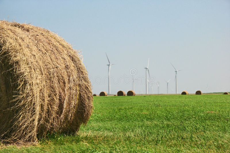 Hay Bale And Wind Turbines stock images