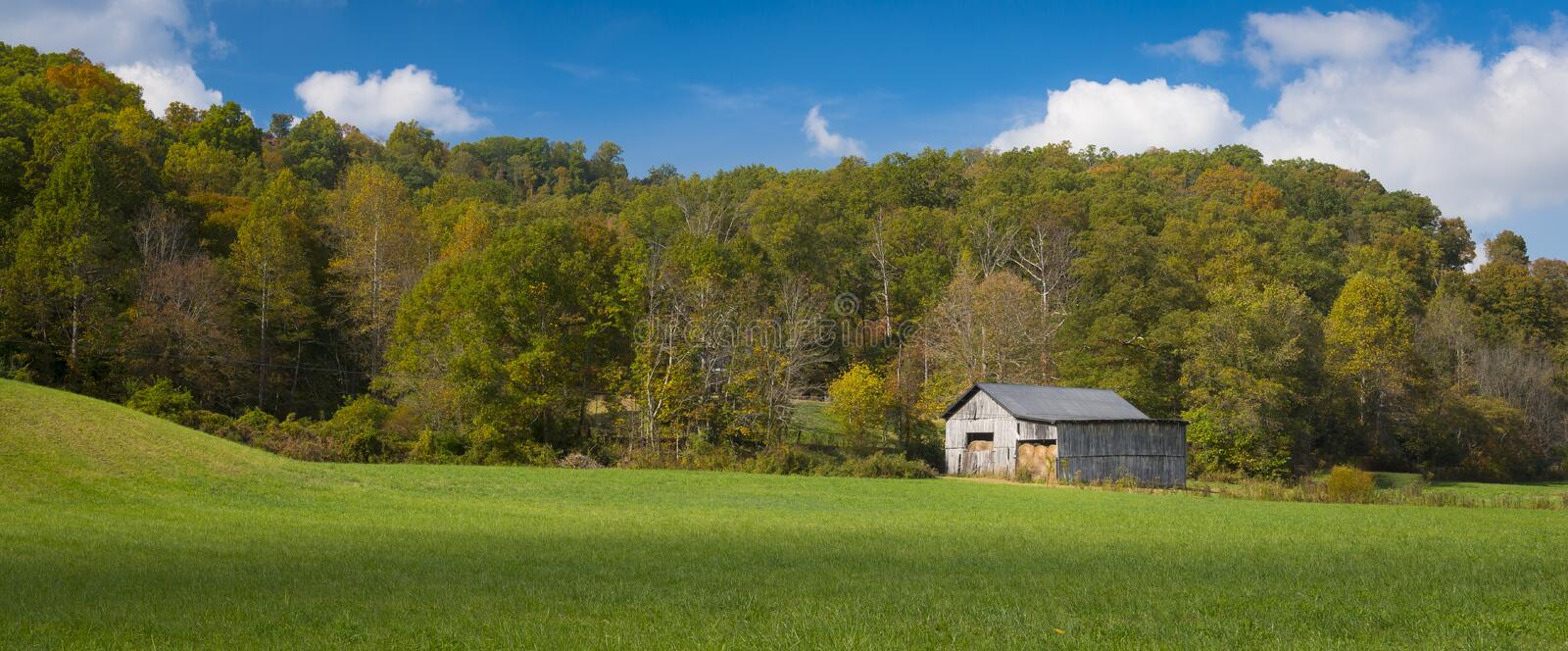 Hay Barn. In a field with Blue Sky stock photography