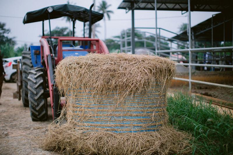 Hay in front of tractor royalty free stock photography