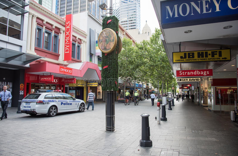 Hay Street Mall Security. PERTH,WA,AUSTRALIA-NOVEMBER 16,2016: Hay Street Mall with Christmas decor, police security and people shopping on a cloudy day in Perth royalty free stock images