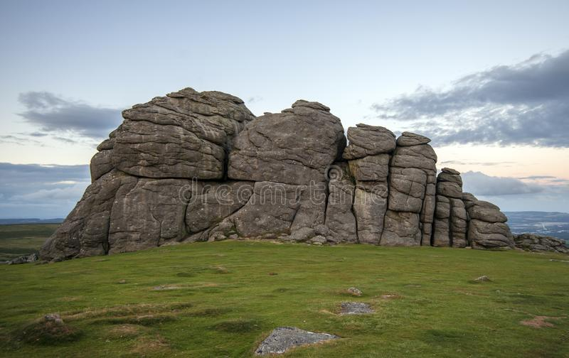 Hay Tor Rocks on Dartmoor in Devon, England. The famous profile of the granite Hay Tor on Dartmoor National Park in Devon. The area has some great walks and royalty free stock photography