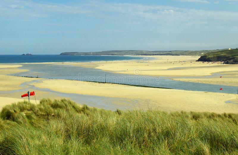 Hayle Estuary, Hayle Cornwall England. Beautiful golden sand, grassy sea dunes and sunny summers day at Hayle Estuary with views down the beach towards Godrevy stock photography