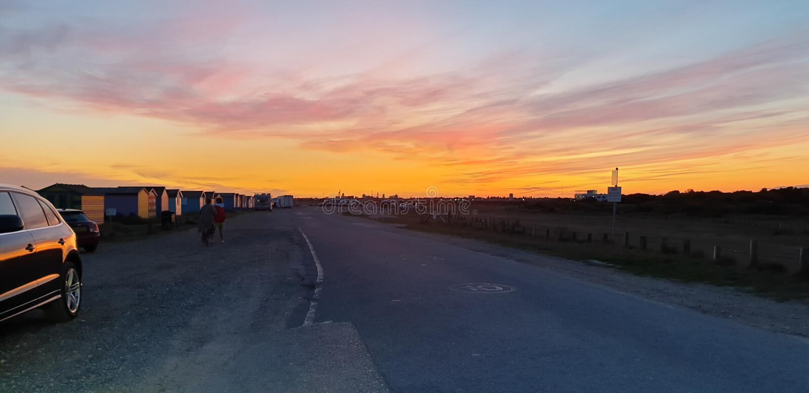 Hayling Island Sunset. With Portsmouth in the background royalty free stock image
