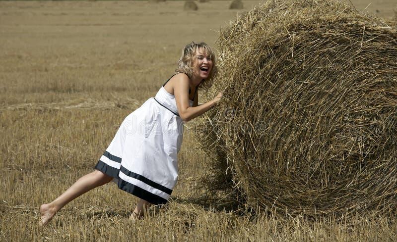 haystack lovely outdoors plying smiling woman στοκ φωτογραφία με δικαίωμα ελεύθερης χρήσης