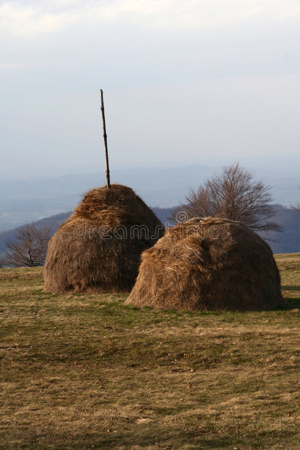 Haystack on a mountain meadow royalty free stock photo