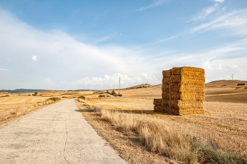 A haystack next to the road in the countryside stock photography