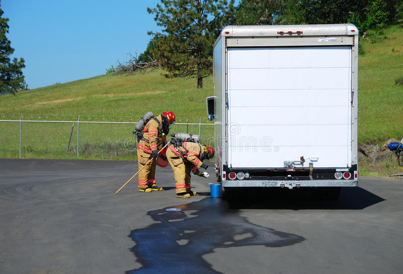 Haz Mat Entry. Fire fighters making a on site recon of a truck leaking fluid, The hazardous materials team trains on a recent corrosive drill in Roseburg Oregon stock photos