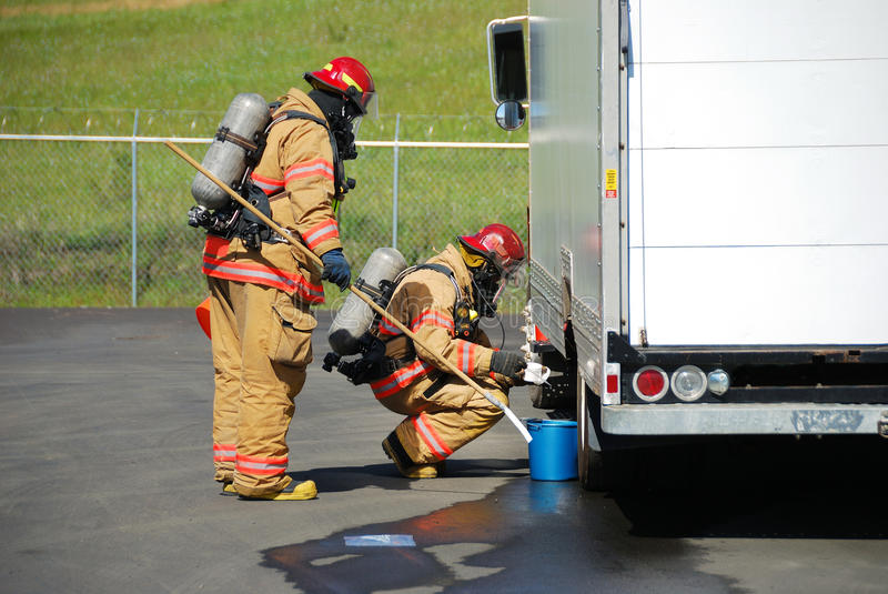Haz Mat Entry. Fire fighters making a on site recon of a truck leaking fluid, The hazardous materials team trains on a recent corrosive drill in Roseburg Oregon royalty free stock photography