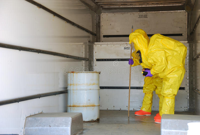 Haz Mat Entry. Fire fighters making entry on a truck leaking fluid, The hazardous materials team trains on a recent corrosive drill in Roseburg Oregon. May 28 royalty free stock images
