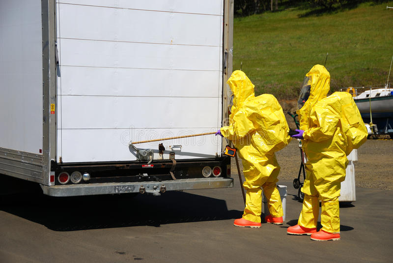 Haz Mat Entry. Fire fighters making entry on a truck leaking fluid, The hazardous materials team trains on a recent corrosive drill in Roseburg Oregon. May 28 stock photos