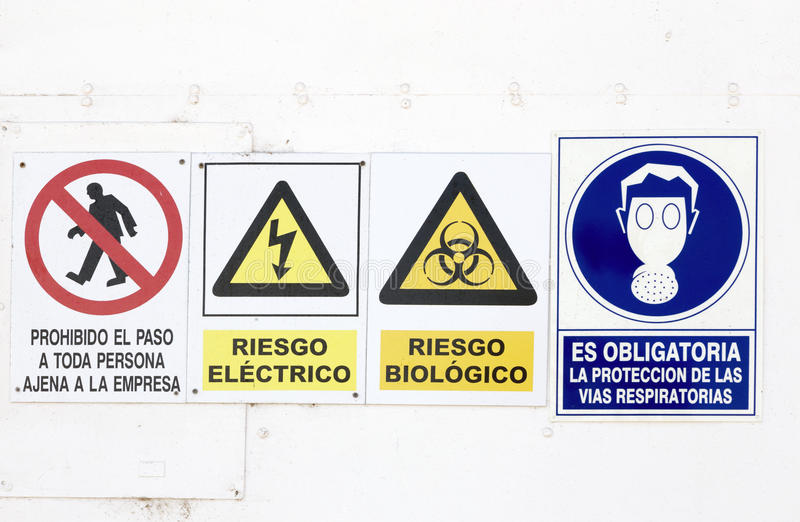 Hazard and danger signs. In a wall stock images