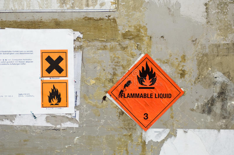 Hazard labels. Hazard notices at a wall royalty free stock photo