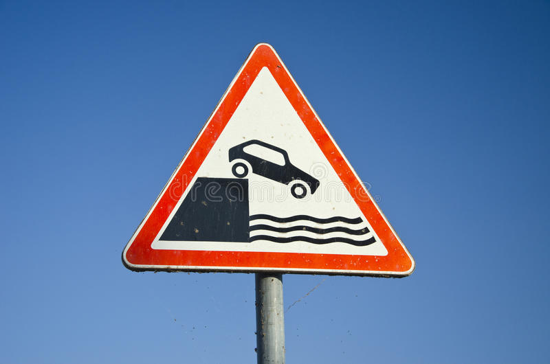 Hazard road signs on sky background. Near sea coast in harbor area stock photography