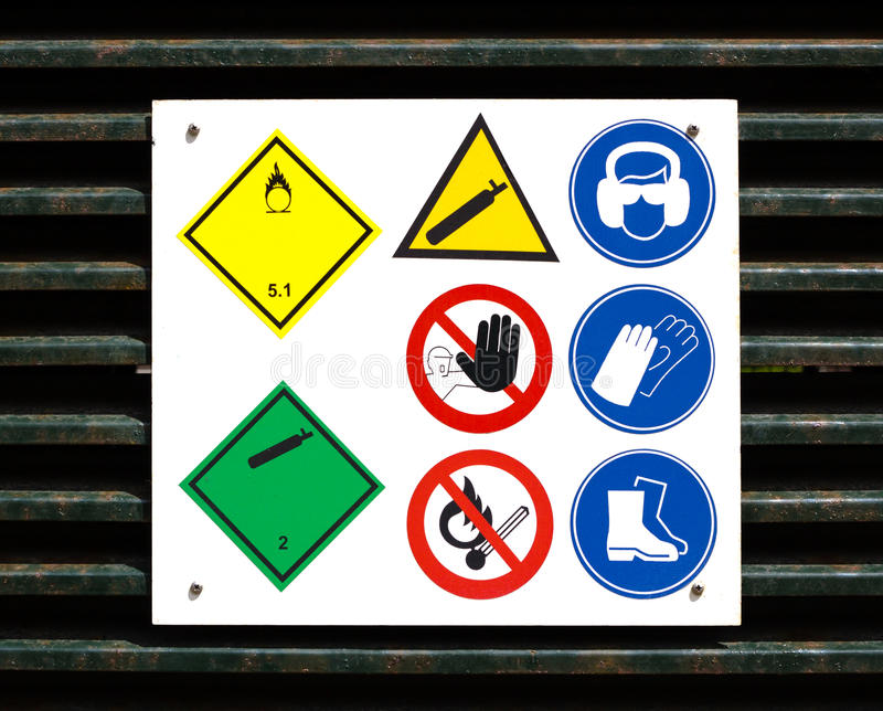 Download Hazard And Safety Symbols On Door Stock Image - Image: 25506877
