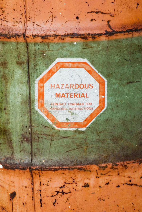 Hazardous Material. Aged, weathered and grungy barrel with a Hazardous Material sticker /warning on it royalty free stock image