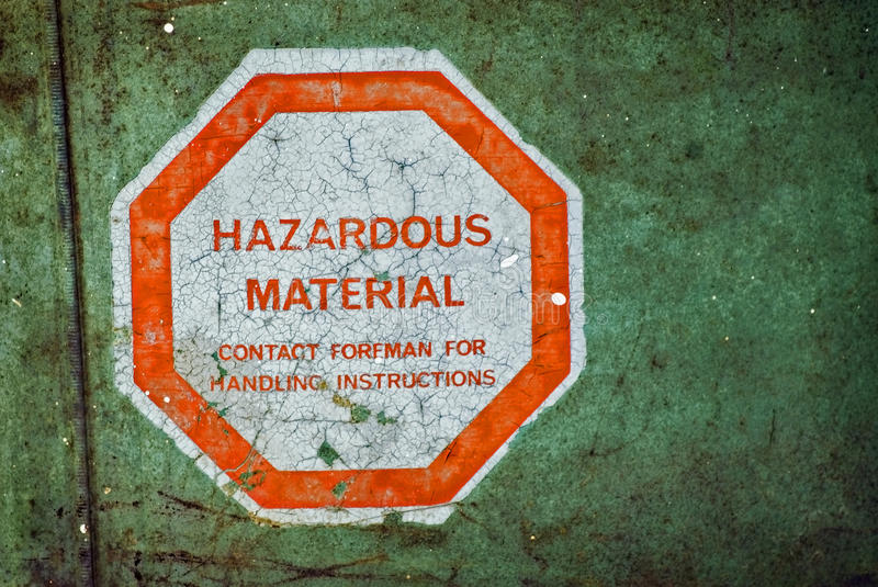 Hazardous Material. Aged, weathered and grungy barrel with a Hazardous Material sticker /warning on it stock photos