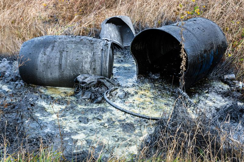 Hazardous waste. Spillage of toxic waste in nature. Hazardous waste. Spillage of industrial toxic waste in nature. Pollution of the environment stock photos