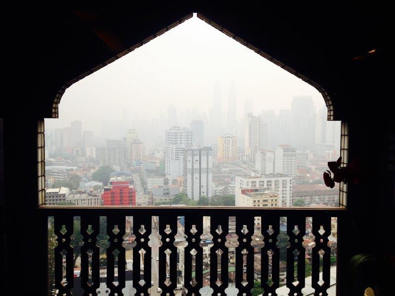 Haze smog pollution over Kuala Lumpur through unique Mosque window stock photos