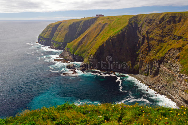 Haze And Sun On Remote Ocean Cliffs Royalty Free Stock Images