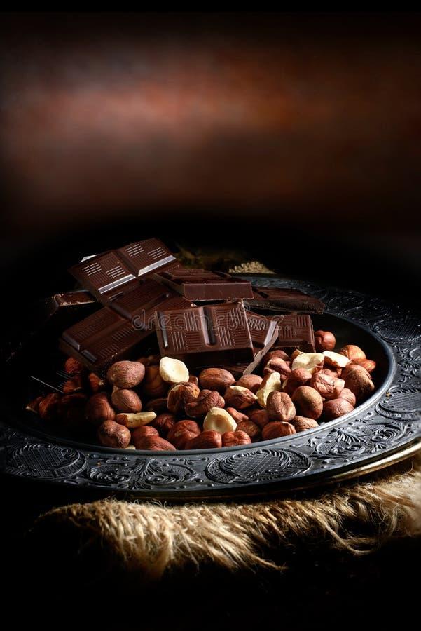 Hazelnoot en chocolade stock foto's